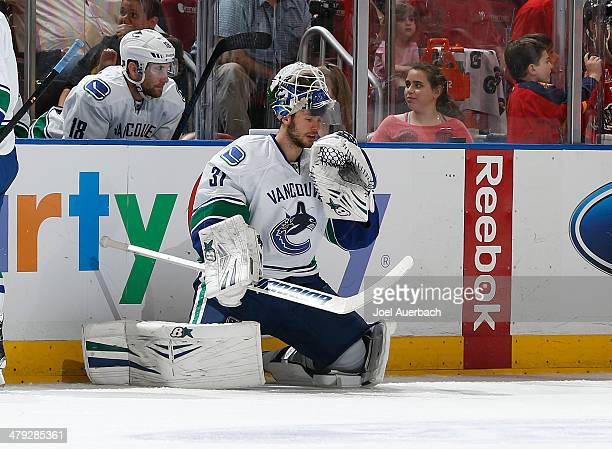 Goaltender Eddie Lack of the Vancouver Canucks checks himself out after being knocked into the net while making a save against the Florida Panthers...