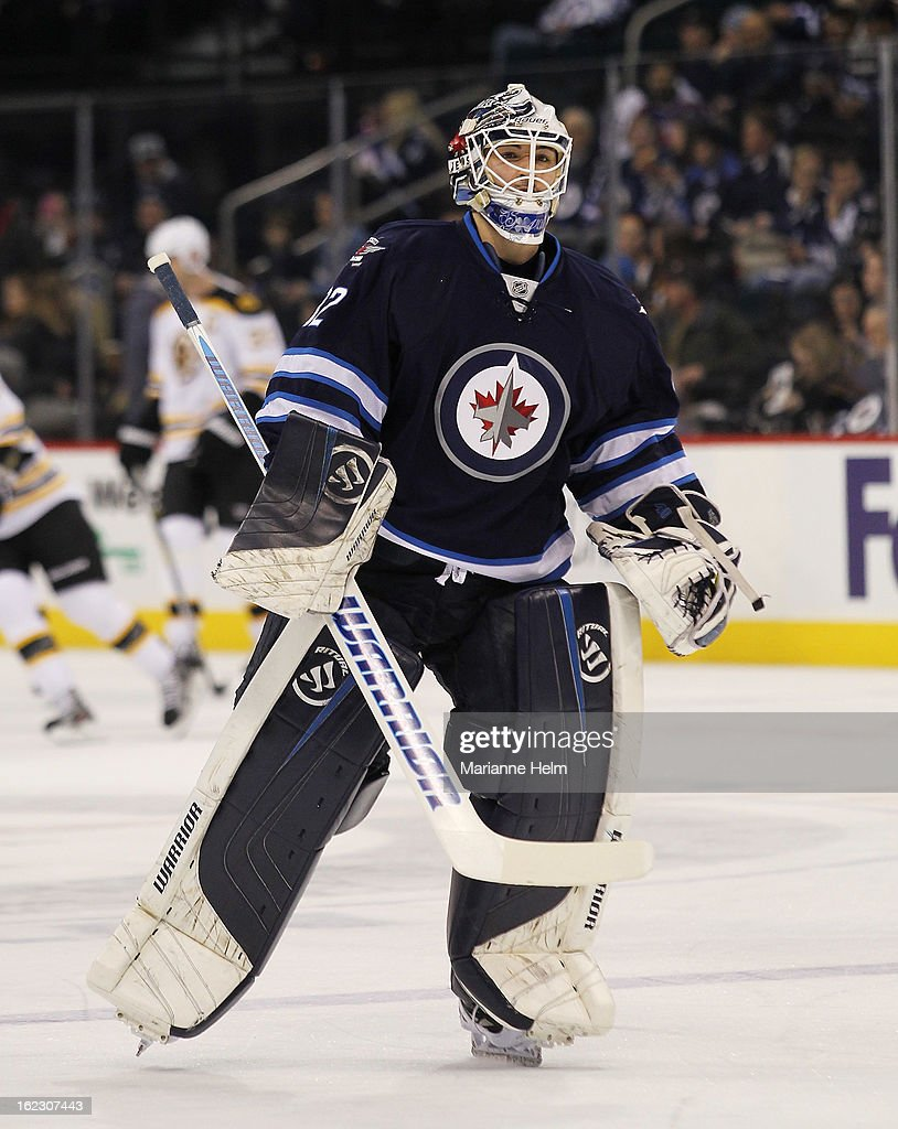 Goaltender Edward Pasquale #32 of the Winnipeg Jets looks around as he skates on the ice during warmup before a game between the Boston Bruins and the Winnipeg Jets on February 17, 2013 at the MTS Centre in Winnipeg, Manitoba, Canada.