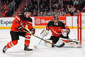 Goaltender Eric Comrie of Team Canada and teammate Joe Hicketts watch as the puck goes wide of the net in a preliminary round game at the 2015 IIHF...