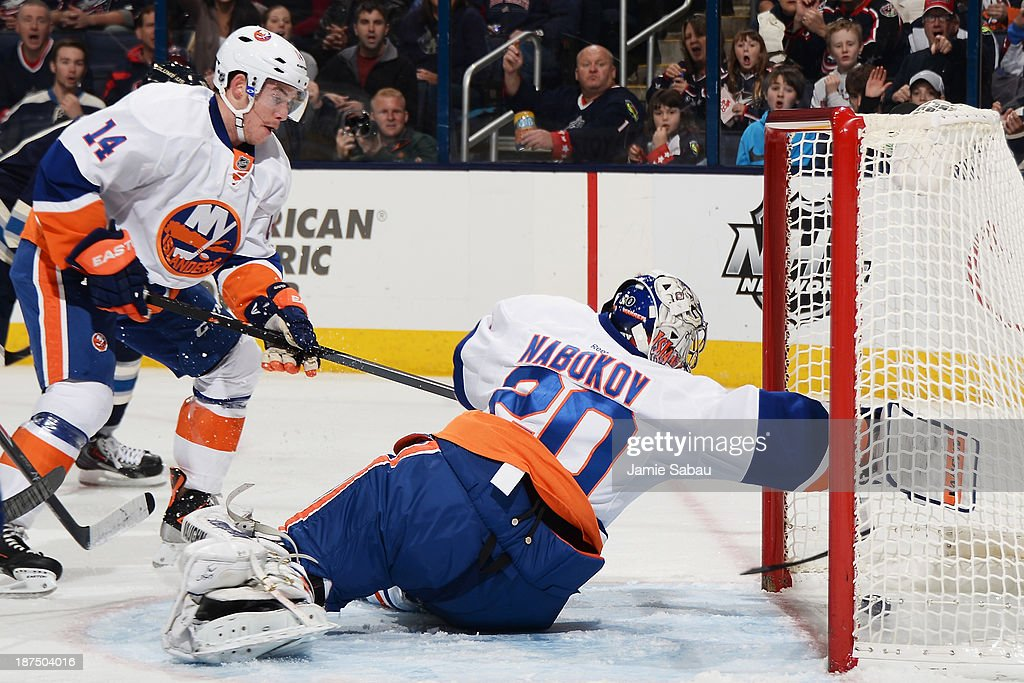 Goaltender Evgeni Nabokov #20 of the New York Islanders is unable to stop a loose puck as it goes into the net against the Columbus Blue Jackets during the first period on November 9, 2013 at Nationwide Arena in Columbus, Ohio.