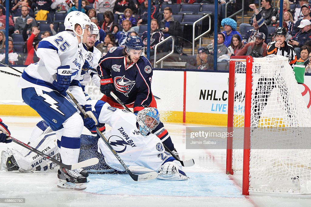 Goaltender <a gi-track='captionPersonalityLinkClicked' href=/galleries/search?phrase=Evgeni+Nabokov&family=editorial&specificpeople=171380 ng-click='$event.stopPropagation()'>Evgeni Nabokov</a> #20 of the Tampa Bay Lightning looks back as a shot from Ryan Johansen #19 of the Columbus Blue Jackets trickles into the net in the third period as Matthew Carle #25 of the Tampa Bay Lightning and <a gi-track='captionPersonalityLinkClicked' href=/galleries/search?phrase=Brian+Gibbons&family=editorial&specificpeople=5134708 ng-click='$event.stopPropagation()'>Brian Gibbons</a> #23 of the Columbus Blue Jackets watch on November 8, 2014 at Nationwide Arena in Columbus, Ohio. Tampa Bay defeated Columbus 7-4.