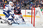 Goaltender Evgeni Nabokov of the Tampa Bay Lightning looks back as a shot from Ryan Johansen of the Columbus Blue Jackets trickles into the net in...