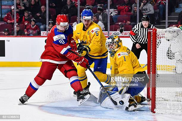 Goaltender Felix Sandstrom of Team Sweden makes a pad save on Alexander Polunin of Team Russia while David Bernhardt tries to defend during the 2017...