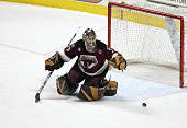 Goaltender Frederic Cassivi of the Hershey Bears makes a stop against the Milwaukee Admirals during game six of the AHL Calder Cup Finals on June 15...