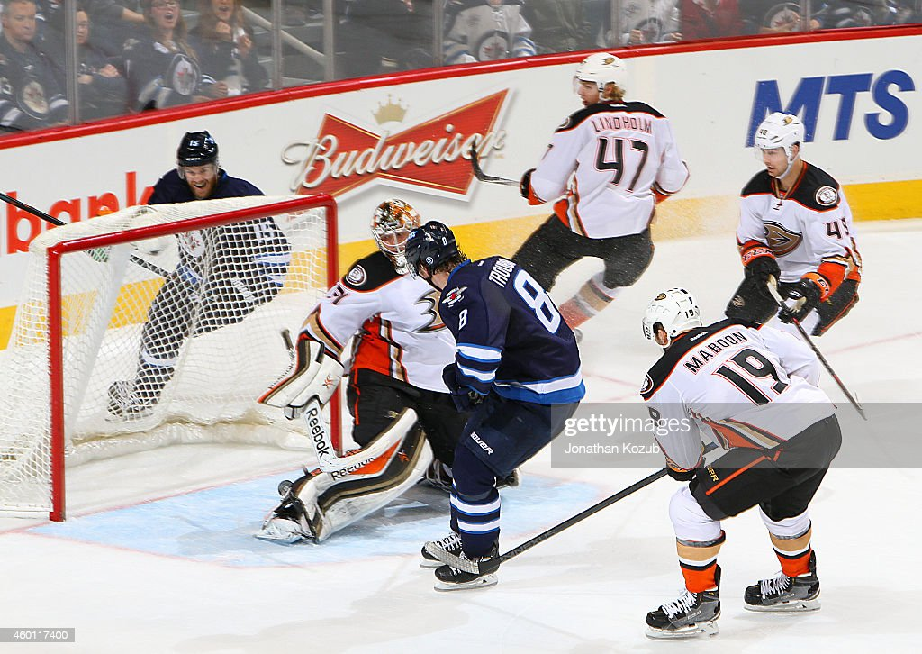 Goaltender <a gi-track='captionPersonalityLinkClicked' href=/galleries/search?phrase=Frederik+Andersen&family=editorial&specificpeople=6605243 ng-click='$event.stopPropagation()'>Frederik Andersen</a> #31 of the Anaheim Ducks looks behind him as the puck shot by <a gi-track='captionPersonalityLinkClicked' href=/galleries/search?phrase=Jacob+Trouba&family=editorial&specificpeople=8050718 ng-click='$event.stopPropagation()'>Jacob Trouba</a> #8 of the Winnipeg Jets rolls toward the net for a third-period goal on December 7, 2014 at the MTS Centre in Winnipeg, Manitoba, Canada.