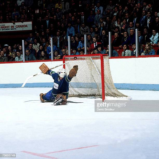 Goaltender Gary Smith of the Vancouver Canucks makes a glove save against the Montreal Canadiens circa 1976 at the Montreal Forum in Montreal Quebec...