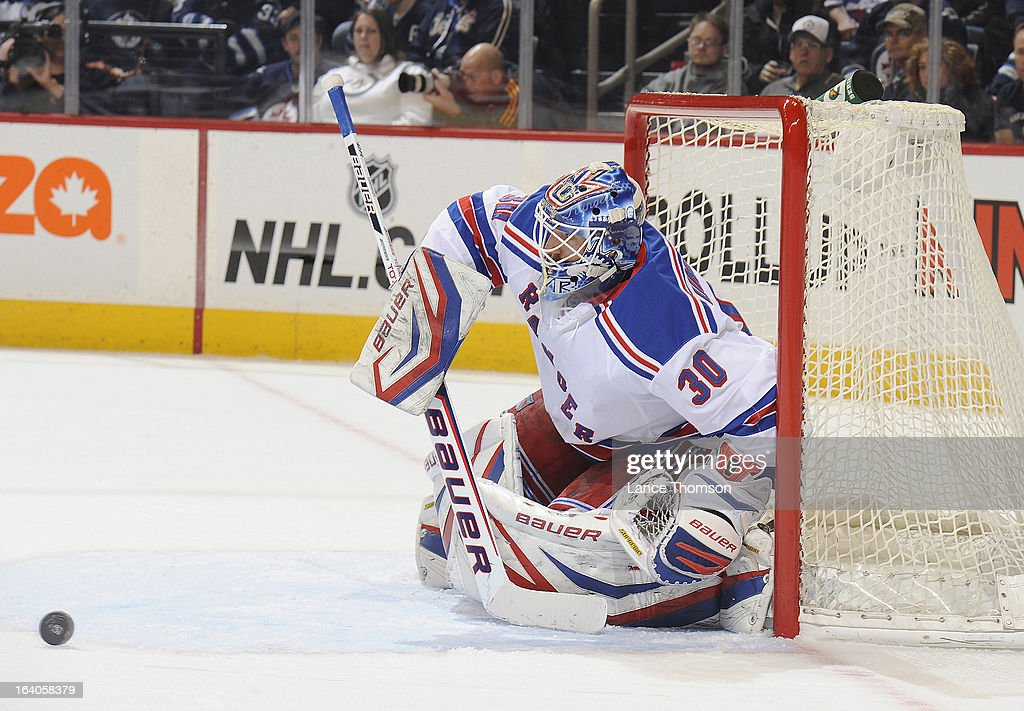 Goaltender <a gi-track='captionPersonalityLinkClicked' href=/galleries/search?phrase=Henrik+Lundqvist&family=editorial&specificpeople=217958 ng-click='$event.stopPropagation()'>Henrik Lundqvist</a> #30 gets set in the crease as the puck rolls towards the goal during first period action against the Winnipeg Jets at the MTS Centre on March 14, 2013 in Winnipeg, Manitoba, Canada. The Jets defeated the Rangers 3-1.