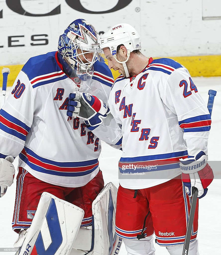 Goaltender <a gi-track='captionPersonalityLinkClicked' href=/galleries/search?phrase=Henrik+Lundqvist&family=editorial&specificpeople=217958 ng-click='$event.stopPropagation()'>Henrik Lundqvist</a> #30 is congratulated by <a gi-track='captionPersonalityLinkClicked' href=/galleries/search?phrase=Ryan+Callahan&family=editorial&specificpeople=809690 ng-click='$event.stopPropagation()'>Ryan Callahan</a> #24 of the New York Rangers at the end of the game against the Florida Panthers at the BB&T Center on November 27, 2013 in Sunrise, Florida. The Rangers defeated the Panthers 5-2.