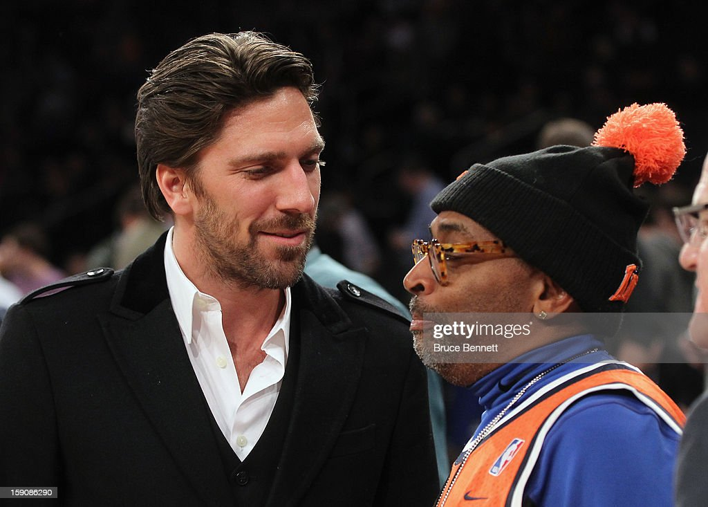 Goaltender Henrik Lundqvist of the New York Rangers (L) and director Spike Lee attend the game between the New York Knicks and the Boston Celtics at Madison Square Garden on January 7, 2013 in New York City.