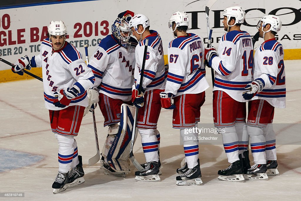 Goaltender <a gi-track='captionPersonalityLinkClicked' href=/galleries/search?phrase=Henrik+Lundqvist&family=editorial&specificpeople=217958 ng-click='$event.stopPropagation()'>Henrik Lundqvist</a> #30 of the New York Rangers celebrates the win with teammates against the Florida Panthers at the BB&T Center on November 27, 2013 in Sunrise, Florida.