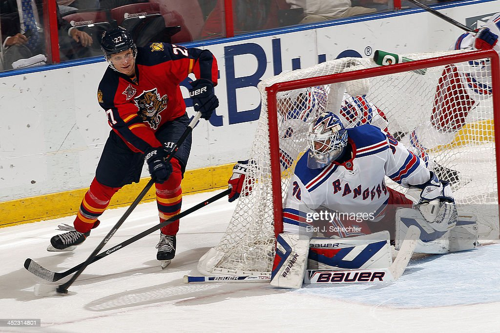 Goaltender <a gi-track='captionPersonalityLinkClicked' href=/galleries/search?phrase=Henrik+Lundqvist&family=editorial&specificpeople=217958 ng-click='$event.stopPropagation()'>Henrik Lundqvist</a> #30 of the New York Rangers defends the net against <a gi-track='captionPersonalityLinkClicked' href=/galleries/search?phrase=Nick+Bjugstad&family=editorial&specificpeople=7029343 ng-click='$event.stopPropagation()'>Nick Bjugstad</a> #27 of the Florida Panthers at the BB&T Center on November 27, 2013 in Sunrise, Florida.