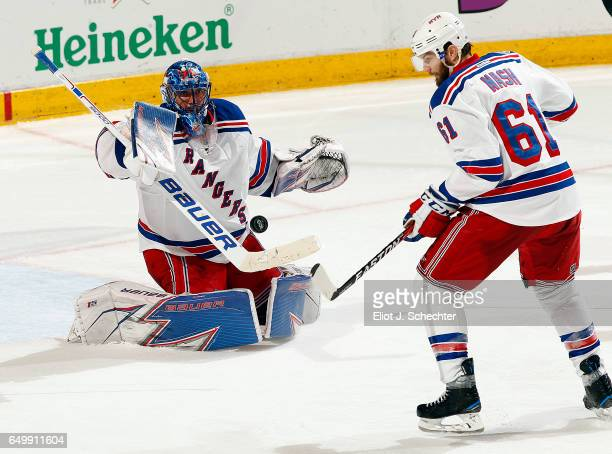 Goaltender Henrik Lundqvist of the New York Rangers defends the net with the help of teammate Rick Nash against the Florida Panthers at the BBT...