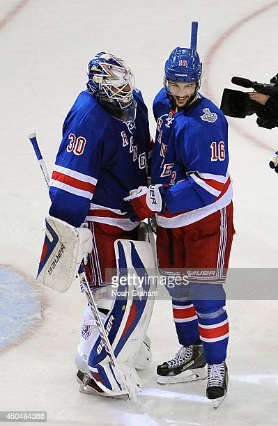 Goaltender Henrik Lundqvist of the New York Rangers is congratulated by teammate Derick Brassard after their team defeated the Los Angeles Kings 21...