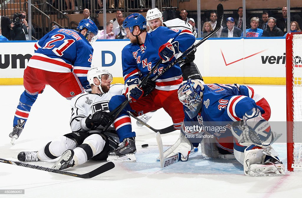 Goaltender <a gi-track='captionPersonalityLinkClicked' href=/galleries/search?phrase=Henrik+Lundqvist&family=editorial&specificpeople=217958 ng-click='$event.stopPropagation()'>Henrik Lundqvist</a> #30 of the New York Rangers looks for the puck in traffic around the net during the second period of Game Three of the 2014 Stanley Cup Final against the Los Angeles Kings at Madison Square Garden on June 9, 2014 in New York City.