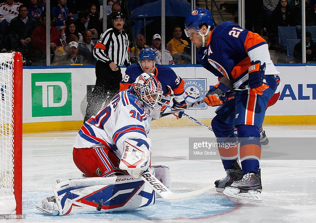 Goaltender Henrik Lundqvist of the New York Rangers makes a point blank pad save off of Kyle Okposo of the New York Islanders on March 31 2011 at...