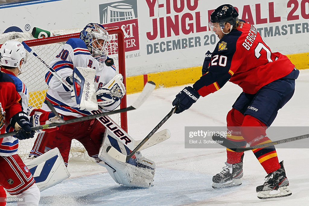 Goaltender <a gi-track='captionPersonalityLinkClicked' href=/galleries/search?phrase=Henrik+Lundqvist&family=editorial&specificpeople=217958 ng-click='$event.stopPropagation()'>Henrik Lundqvist</a> #30 of the New York Rangers makes a save against <a gi-track='captionPersonalityLinkClicked' href=/galleries/search?phrase=Sean+Bergenheim&family=editorial&specificpeople=208830 ng-click='$event.stopPropagation()'>Sean Bergenheim</a> #20 of the Florida Panthers at the BB&T Center on November 27, 2013 in Sunrise, Florida.