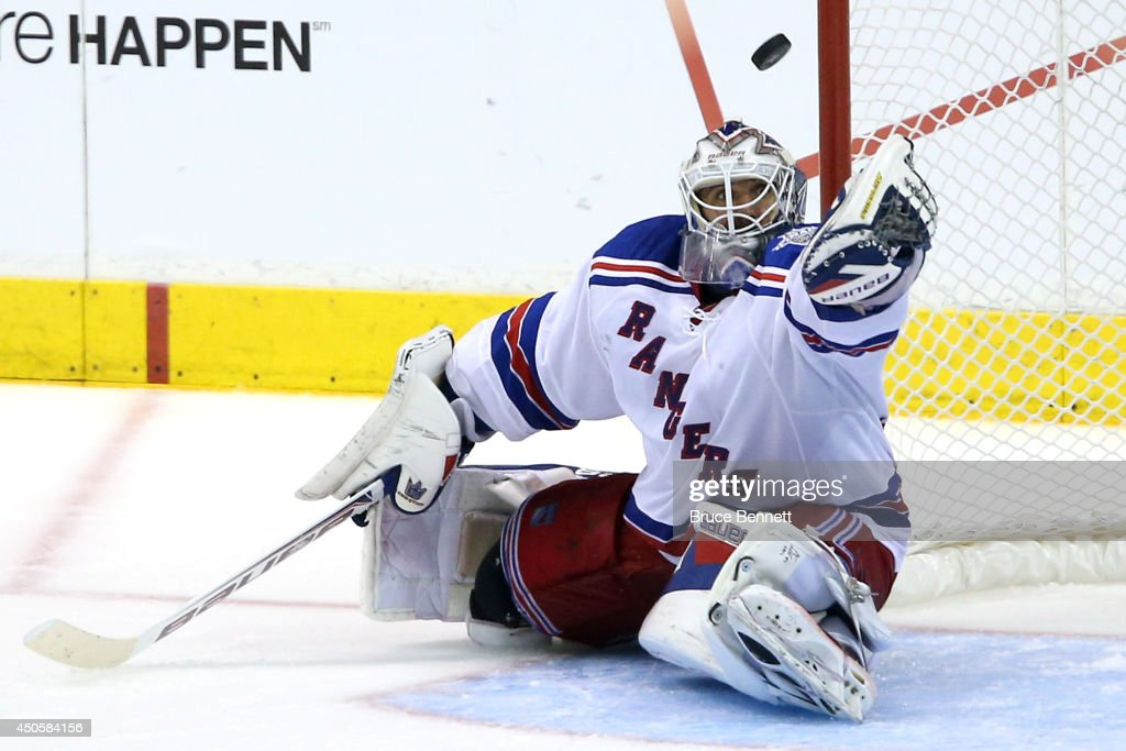 Goaltender Henrik Lundqvist of the New York Rangers makes a save against the Los Angeles Kings in the third period during Game Five of the 2014...