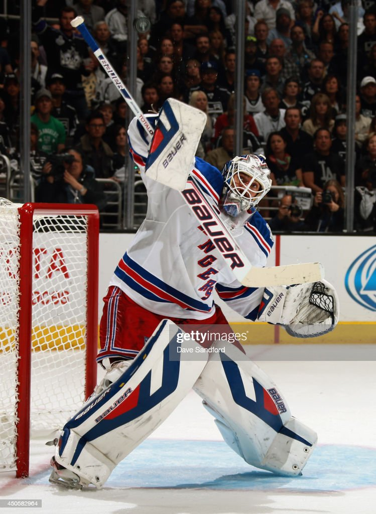 Goaltender Henrik Lundqvist of the New York Rangers makes a stick save against the Los Angeles Kings in the second period of Game Five of the 2014...
