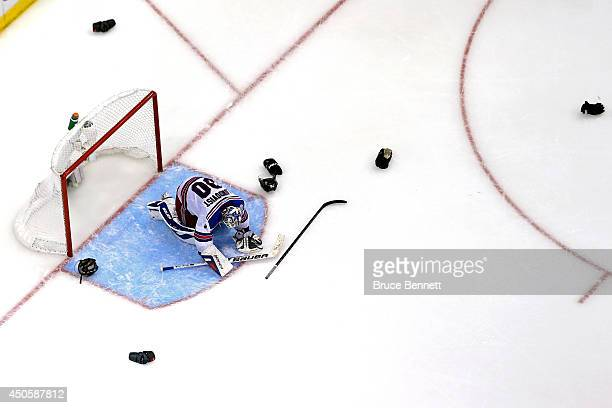 Goaltender Henrik Lundqvist of the New York Rangers reacts after being defeated by the Los Angeles Kings 32 in Game Five of the 2014 Stanley Cup...