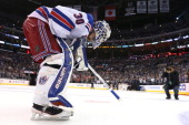 Goaltender Henrik Lundqvist of the New York Rangers skates off the ice after losing 32 to the Los Angeles Kings in double overtime during Game Five...