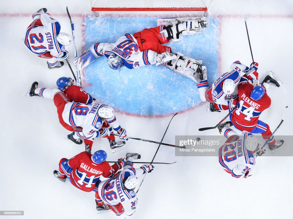 Goaltender Henrik Lundqvist #30 of the New York Rangers spreads himself out to defend his net against the Montreal Canadiens in Game Two of the Eastern Conference First Round during the 2017 NHL Stanley Cup Playoffs at the Bell Centre on April 14, 2017 in Montreal, Quebec, Canada. The Montreal Canadiens defeated the New York Rangers 4-3 in overtime.