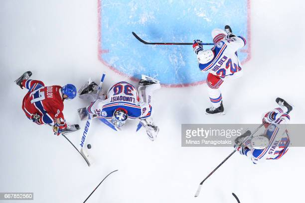 Goaltender Henrik Lundqvist of the New York Rangers stops Alexander Radulov of the Montreal Canadiens in Game One of the Eastern Conference First...