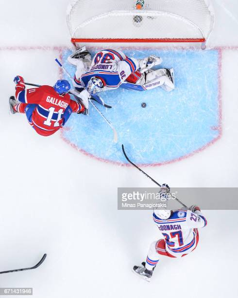 Goaltender Henrik Lundqvist of the New York Rangers stops Brendan Gallagher of the Montreal Canadiens in Game Five of the Eastern Conference First...