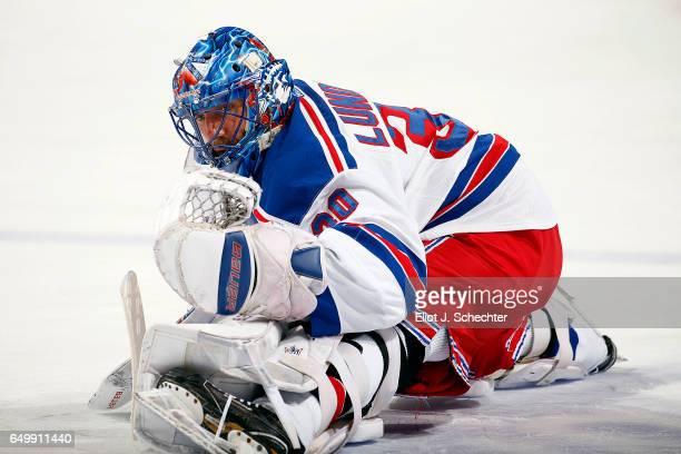 Goaltender Henrik Lundqvist of the New York Rangers stretches on the ice prior to the start of the game against the Florida Panthers at the BBT...