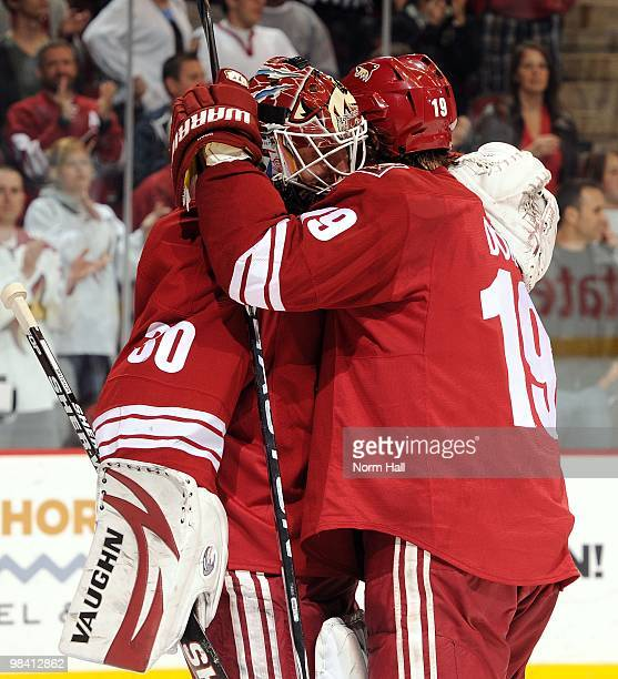 Goaltender Ilya Bryzgalov and teammate Shane Doan of the Phoenix Coyotes celebrate a victory against the Nashville Predators on April 7 2010 at...