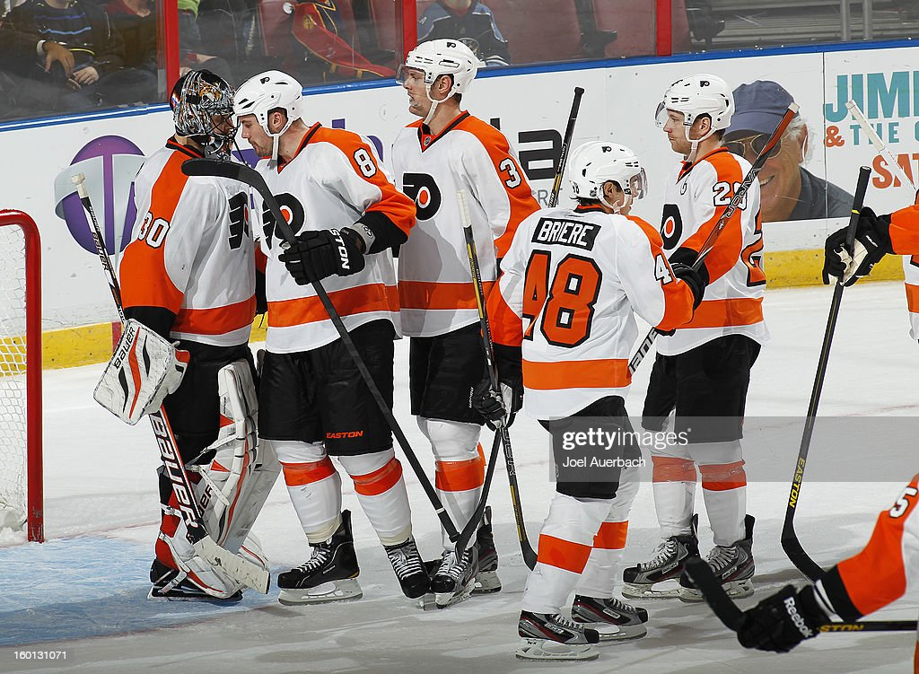 Goaltender <a gi-track='captionPersonalityLinkClicked' href=/galleries/search?phrase=Ilya+Bryzgalov&family=editorial&specificpeople=2285430 ng-click='$event.stopPropagation()'>Ilya Bryzgalov</a> #30 is congratulated by <a gi-track='captionPersonalityLinkClicked' href=/galleries/search?phrase=Nicklas+Grossman&family=editorial&specificpeople=2284863 ng-click='$event.stopPropagation()'>Nicklas Grossman</a>n #8 of the Philadelphia Flyers after the game against the Florida Panthers at the BB&T Center on January 26, 2013 in Sunrise, Florida. The Flyers defeated the Panthers 7-1.