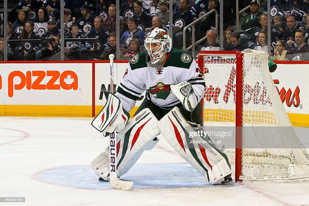 Goaltender Ilya Bryzgalov #30 of the Minnesota Wild defends the net during third period action against the Winnipeg Jets at the MTS Centre on April 7, 2014 in Winnipeg, Manitoba, Canada. The Wild defeated the Jets 1-0.