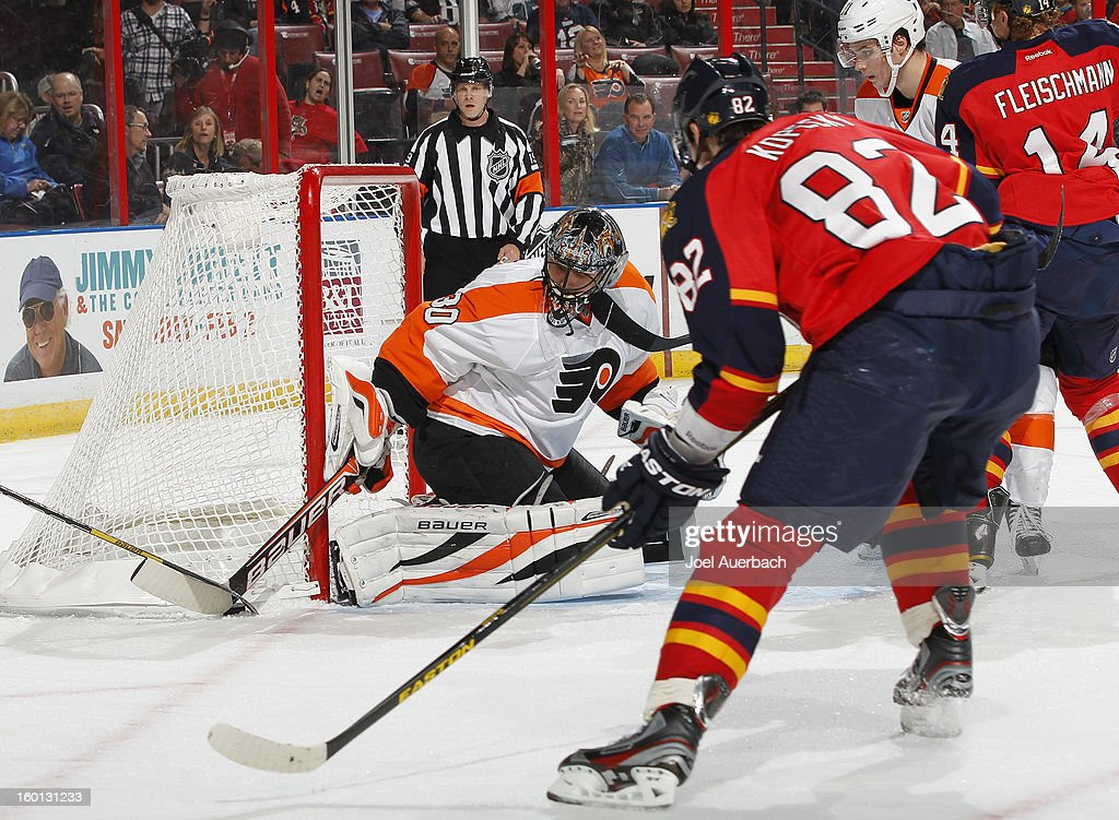 Goaltender <a gi-track='captionPersonalityLinkClicked' href=/galleries/search?phrase=Ilya+Bryzgalov&family=editorial&specificpeople=2285430 ng-click='$event.stopPropagation()'>Ilya Bryzgalov</a> #30 of the Philadelphia Flyers defends the net as <a gi-track='captionPersonalityLinkClicked' href=/galleries/search?phrase=Tomas+Kopecky&family=editorial&specificpeople=2234349 ng-click='$event.stopPropagation()'>Tomas Kopecky</a> #82 of the Florida Panthers looks for a rebound attempt at the BB&T Center on January 26, 2013 in Sunrise, Florida. The Flyers defeated the Panthers 7-1.