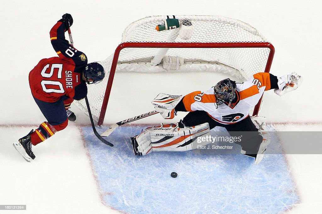 Goaltender <a gi-track='captionPersonalityLinkClicked' href=/galleries/search?phrase=Ilya+Bryzgalov&family=editorial&specificpeople=2285430 ng-click='$event.stopPropagation()'>Ilya Bryzgalov</a> #30 of the Philadelphia Flyers defends the net against Drew Shore #50 of the Florida Panthers at the BB&T Center on January 26, 2013 in Sunrise, Florida.