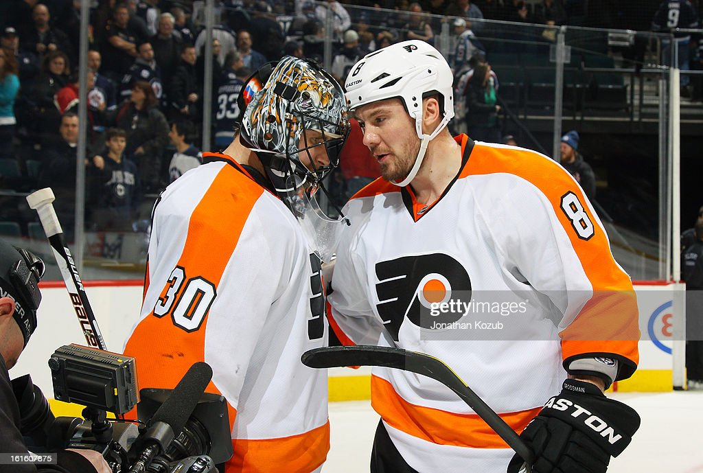 Goaltender <a gi-track='captionPersonalityLinkClicked' href=/galleries/search?phrase=Ilya+Bryzgalov&family=editorial&specificpeople=2285430 ng-click='$event.stopPropagation()'>Ilya Bryzgalov</a> #30 of the Philadelphia Flyers gets congratulated by teammate <a gi-track='captionPersonalityLinkClicked' href=/galleries/search?phrase=Nicklas+Grossman&family=editorial&specificpeople=2284863 ng-click='$event.stopPropagation()'>Nicklas Grossman</a>n #8 following a 3-2 victory over the Winnipeg Jets at the MTS Centre on February 12, 2013 in Winnipeg, Manitoba, Canada.