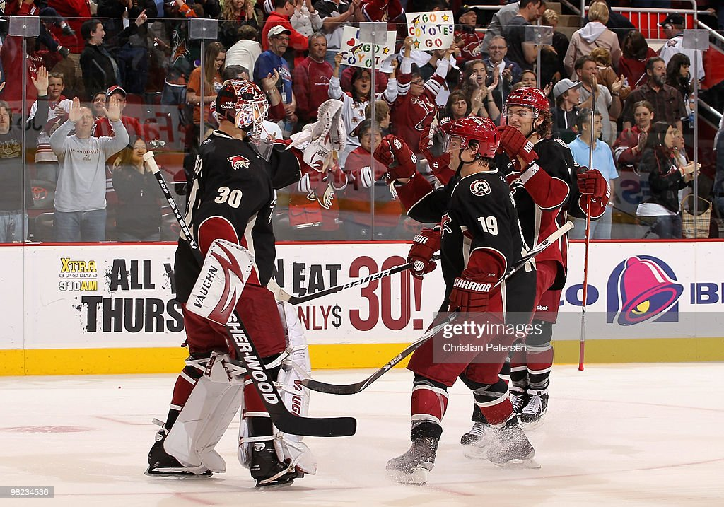Goaltender Ilya Bryzgalov of the Phoenix Coyotes celebrates with teammates Shane Doan and Martin Hanzal after defeating the Edmonton Oilers in the...