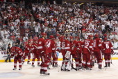 Goaltender Ilya Bryzgalov of the Phoenix Coyotes reacts with teammates after being defeated by the Detroit Red Wings in Game Four of the Western...