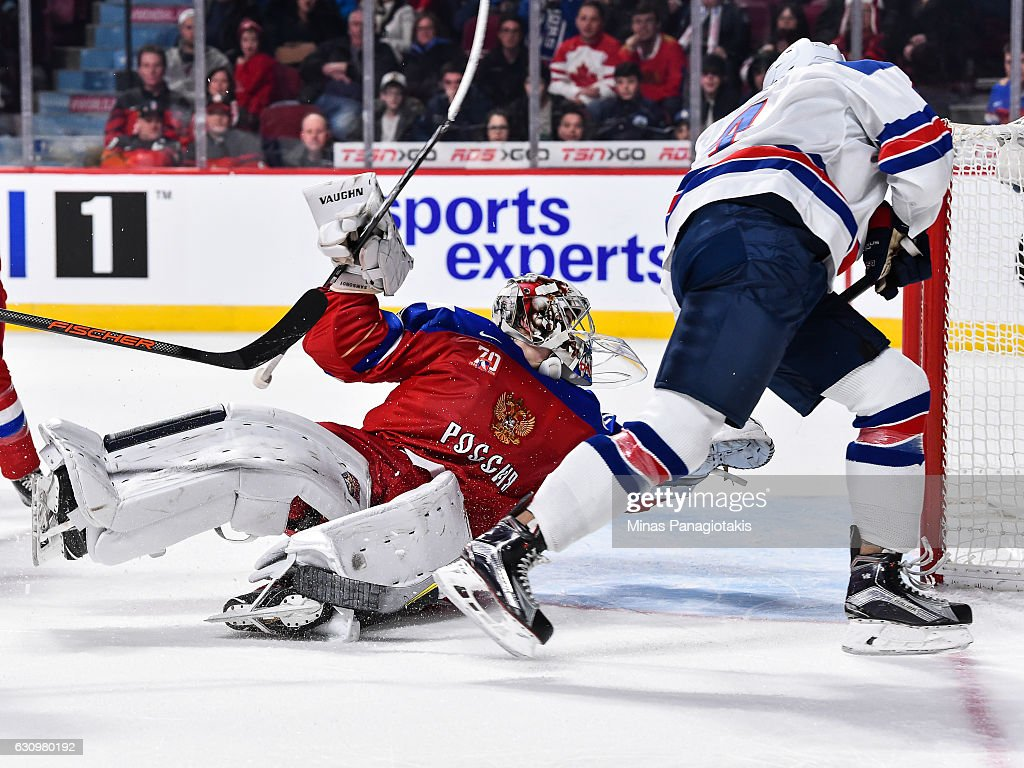 Goaltender Ilya Samsonov #30 of Team Russia makes a save on Caleb Jones #4 of Team United States during the 2017 IIHF World Junior Championship semifinal game at the Bell Centre on January 4, 2017 in Montreal, Quebec, Canada. The Team United States defeated Team Russia 4-3 in a shootout.