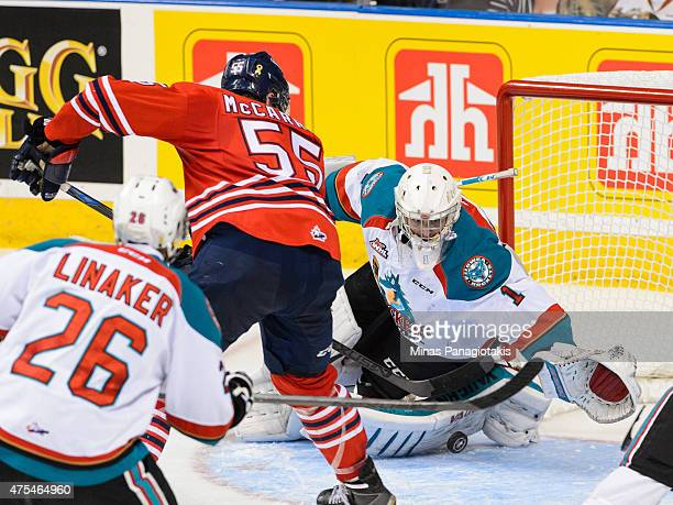 Goaltender Jackson Whistle of the Kelowna Rockets makes a pad save on Michael McCarron of the Oshawa Generals during the 2015 Memorial Cup...