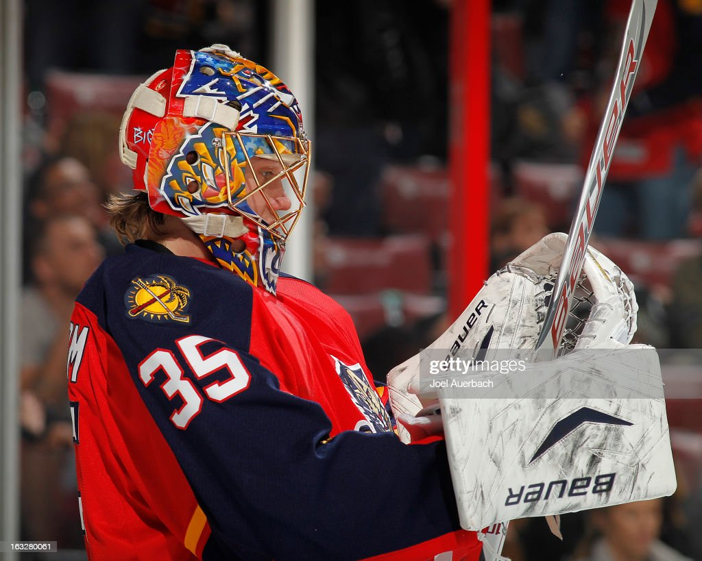 Goaltender Jacob Markstrom #35 of the Florida Panthers adjusts his equipment during a break in action against the Winnipeg Jets at the BB&T Center on March 5, 2013 in Sunrise, Florida. The Panthers defeated the Jets 4-1.