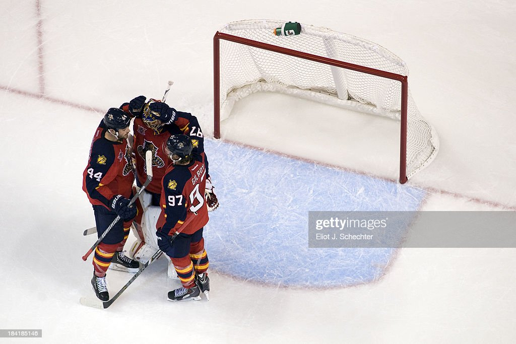 Goaltender <a gi-track='captionPersonalityLinkClicked' href=/galleries/search?phrase=Jacob+Markstrom&family=editorial&specificpeople=5370948 ng-click='$event.stopPropagation()'>Jacob Markstrom</a> #25 of the Florida Panthers celebrates a win with teammates <a gi-track='captionPersonalityLinkClicked' href=/galleries/search?phrase=Erik+Gudbranson&family=editorial&specificpeople=5741800 ng-click='$event.stopPropagation()'>Erik Gudbranson</a> #44 and <a gi-track='captionPersonalityLinkClicked' href=/galleries/search?phrase=Matt+Gilroy&family=editorial&specificpeople=817917 ng-click='$event.stopPropagation()'>Matt Gilroy</a> #97 against the Pittsburgh Penguins at the BB&T Center on October 11, 2013 in Sunrise, Florida.