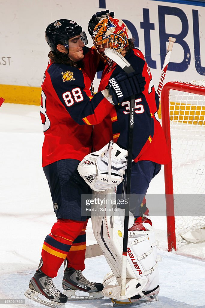 Goaltender <a gi-track='captionPersonalityLinkClicked' href=/galleries/search?phrase=Jacob+Markstrom&family=editorial&specificpeople=5370948 ng-click='$event.stopPropagation()'>Jacob Markstrom</a> #35 of the Florida Panthers celebrates with teammate Peter Mueller #88 their win against the New York Rangers at the BB&T Center on April 23, 2013 in Sunrise, Florida.