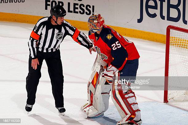 Goaltender Jacob Markstrom of the Florida Panthers chats with Referee Kevin Pollock during a break in the action against the the Chicago Blackhawks...