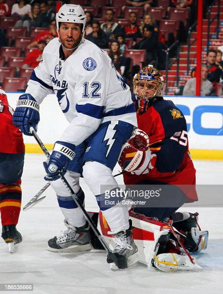 Goaltender Jacob Markstrom of the Florida Panthers defends the net against Ryan Malone of the Tampa Bay Lightning at the BBT Center on October 27...