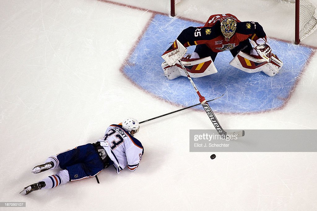 Goaltender <a gi-track='captionPersonalityLinkClicked' href=/galleries/search?phrase=Jacob+Markstrom&family=editorial&specificpeople=5370948 ng-click='$event.stopPropagation()'>Jacob Markstrom</a> #25 of the Florida Panthers defends the net against <a gi-track='captionPersonalityLinkClicked' href=/galleries/search?phrase=Ales+Hemsky&family=editorial&specificpeople=202828 ng-click='$event.stopPropagation()'>Ales Hemsky</a> #83 of the Edmonton Oilers at the BB&T Center on November 5, 2013 in Sunrise, Florida.