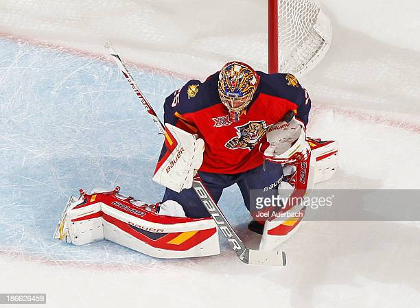 Goaltender Jacob Markstrom of the Florida Panthers gets hit in the shoulder by the puck shot by the St Louis Blues at the BBT Center on November 1...