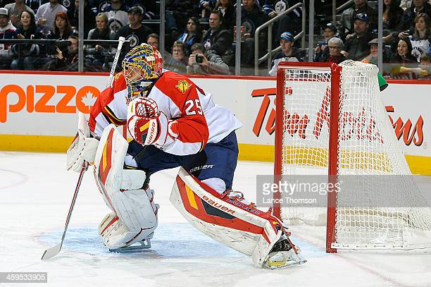Goaltender Jacob Markstrom of the Florida Panthers gets set in the crease during first period action against the Winnipeg Jets at the MTS Centre on...