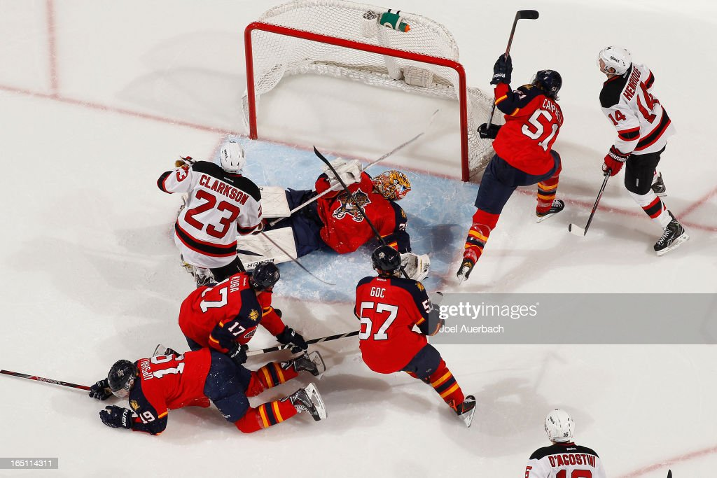 Goaltender <a gi-track='captionPersonalityLinkClicked' href=/galleries/search?phrase=Jacob+Markstrom&family=editorial&specificpeople=5370948 ng-click='$event.stopPropagation()'>Jacob Markstrom</a> #35 of the Florida Panthers looks back after making a save with David Clarkson #23 of the New Jersey Devils in front of the net at the BB&T Center on March 30, 2013 in Sunrise, Florida. The Panthers defeated the Devils 3-2 in overtime.
