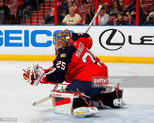 Goaltender Jacob Markstrom of the Florida Panthers makes a glove save against the Los Angeles Kings at the BBT Center on October 13 2013 in Sunrise...