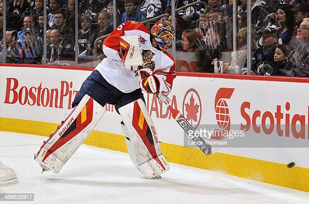Goaltender Jacob Markstrom of the Florida Panthers shoots the puck around the boards during first period action against the Winnipeg Jets at the MTS...
