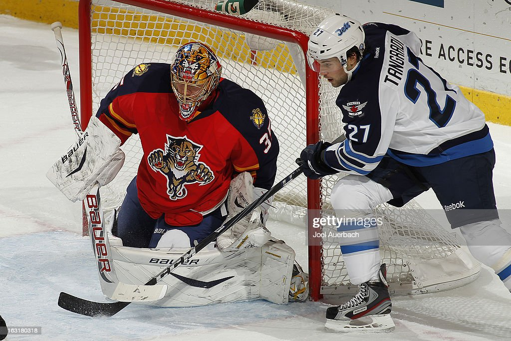 Goaltender <a gi-track='captionPersonalityLinkClicked' href=/galleries/search?phrase=Jacob+Markstrom&family=editorial&specificpeople=5370948 ng-click='$event.stopPropagation()'>Jacob Markstrom</a> #35 of the Florida Panthers stops a shot by <a gi-track='captionPersonalityLinkClicked' href=/galleries/search?phrase=Eric+Tangradi&family=editorial&specificpeople=4361715 ng-click='$event.stopPropagation()'>Eric Tangradi</a> #27 of the Winnipeg Jets at the BB&T Center on March 5, 2013 in Sunrise, Florida. The Panthers defeated the Jets 4-1.